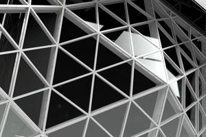 """<div class=""""bildtext"""">Das Atrium ist statisch autonom, die Lasten werden über Brückenlager als Anbindungspunkte zum Gebäudetragwerk abgetragen.</div>"""
